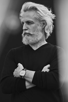 The Maison celebrates the dandies of our time with a series of portraits. Here, French actor Sébastien Le Rest radiates Parisian elegance wearing a timeless Dandy watch with a Bayadère-striped fabric strap. Long Gray Hair, Men With Grey Hair, Hair And Beard Styles, Long Hair Styles, Older Mens Hairstyles, Grey Beards, Poses For Men, Men's Grooming, Male Face