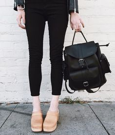 Leather accessories + a seriously rogue pinky finger. Clogs by @swedishhasbeens, backpack by @grafea.