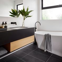 R U S H ➕ V I V I D S L I M L I N E We absolutely love the black, white and timber styling in this stunning ensuite in The Langham 44 house from ! This bathroom features our Rush Wall Set and Vivid Slimline Floor Mounted Bath Mixer, b Bathroom Renos, Bathroom Renovations, Bathroom Interior, Small Bathroom, Bathroom With Window, Bathroom Modern, Bathroom Ideas, Minimal Bathroom, Bathroom Windows