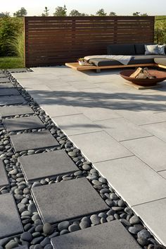 This backyard patio design is inspired by our Blu Grande Smooth patio slab. Perfect paving slab for Paving Stone Patio, Patio Slabs, Concrete Backyard, Patio Tiles, Garden Paving, Garden Paths, Colored Concrete Patio, Concrete Paving Slabs, Garden Slabs