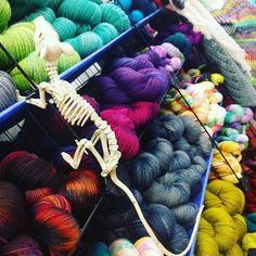 My teenager is decorating the studio ready for @fluphshop 's trunk show on Saturday although I'm mostly year-round ready for Halloween. . . . #countessablaze #yarn #halloween #skeleton #Manchester