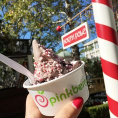 Enjoying holiday treats like our Peppermint Cookies & Cream flavor at the North Pole! #Pinkberry #ChristmasEve