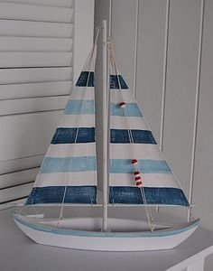 A blue and white wooden yacht from The White Lighthouse...I really need to do a Sea themed room again....