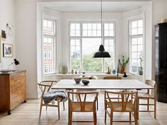 Lovely, inviting dining room with hardwood floor and modern furniture.