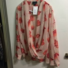 Brand new with tags dress shirt Brand new cream colored blues with orange flowers blouse. Lumiere Tops Blouses