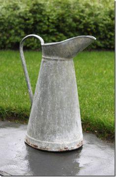 Zinc pitcher  http://fishtailcottage.blogspot.com/2011/10/ruffles-rust-finds.html