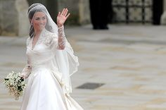 Behind a Veil  Kate Middleton waves as she arrives at the West Door of Westminster Abbey in London for her wedding to Britain's Prince William, on April 29, 2011.