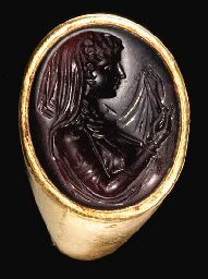 A GREEK GOLD AND GARNET FINGER RING PTOLEMAIC PERIOD, CIRCA EARLY 3RD CENTURY B.C.