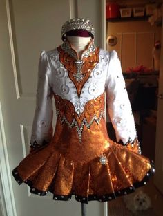 Irish Dance Solo Dress Costume by Sew Irish.  I love the coppery colors and the design reminds me a a princess somehow.  Very simple and elegant overall.