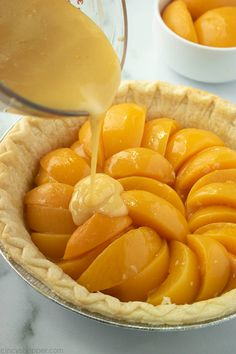 Custard Peach Pie is sweet, creamy, and oh so delicious! We make it with creamy custard, fresh or canned peaches, and top it with crumb topping.