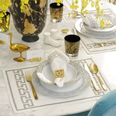 Channel Jonathan Adler when you set your dining table. We love a patterned placemat and surreal objects as a centerpiece.