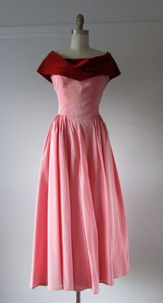 vintage 1950s formal gown iridescent pink satin with red velvet trim draped around the bust and shoulders big, full skirt with lots of gathers at the
