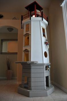 This lighthouse is an iconic item for any room and features cat . - This lighthouse is an iconic item for any room and offers cats a perfect … - Cat Playground, Playground Design, Diy Cat Tree, Cat Towers, Cat Enclosure, Pet Furniture, Furniture Ideas, Furniture Removal, Furniture Online
