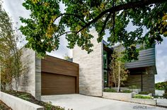 Modern entry, garage, driveway, Wisconsin Modern Riverfront project by dSPACE Studio, Ltd. AIA