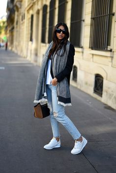 Kayla Seah pairs an oversized scarf with washed out denim jeans and a pair of fresh white trainers; a casual but stylish look. Shoes: Vondelpark.