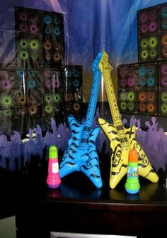 80's blow-up guitars and those cordless toy microphones as photo booth props, perhaps.