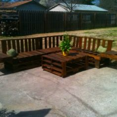 Outdoor seating area from old pallets - I love a clever re-use!