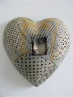 Sally and Neil MacDonell Ceramics. I like the idea of creating a window into the work.