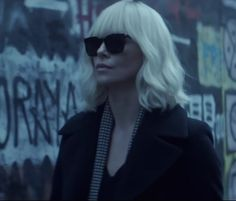 The black sunglasses that Charlize Theron (Lorraine Broughton) wears in the movie Atomic Blonde (2017)