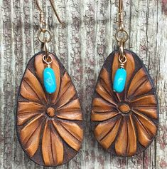 These super trendy J. Forks  Tooled Daisy Teardrop Earrings are simply to die for! Featuring gold hooks. one turquoise accent stone, and finished off with a tooled, teardrop leather piece! These are comfortable, light weight, and chic! They will look fabulous with anything you wear! https://cowgirlkim.com/collections/whats-new/products/j-forks-tooled-daisy-teardrop-earrings