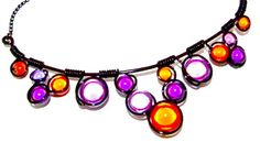 Orange and Purple Miracle Beads Wrapped in Black by CarrieEastwood