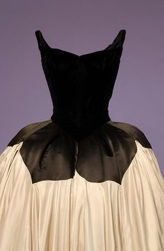 "Charles James (American; 1906–1978)        ""Petal"" Ballgown        Black velvet and silk satin, 1951        Ballgown        Black silk chiffon, silk satin, netting, and boning, 1954–55        Museum at The Fashion Institute of Technology, New York"