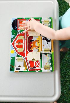 Hide and seek board, 20 activities for 12-18 months old, 20 play ideas for toddlers, activities for one year old, montessori activities for a toddler, development promoting activities for toddlers, activities for 13 month old, activities for 14 month old, activities for 15 month old, activities for 16 month old, activities for 17 month old, activities for 18 month old, activities for a toddler, activities for one year olds, activities for two year olds