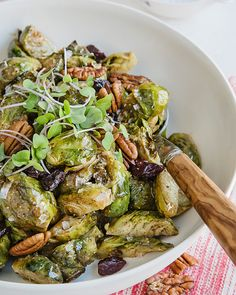 Spicy Brussel Sprouts with Honey Almond Butter, Cranberries, and Pecans - http://www.sweetpaulmag.com/food/spicy-brussel-sprouts-with-honey-almond-butter-cranberries-and-pecans #sweetpaul