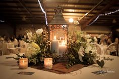 Gorgeous romantic lantern centerpiece with flowers and burlap