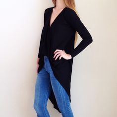 | new | black surplice high low top offers welcome new without tag size extra small black surplice top with high low hem and lace detail on back. •760733• Xhilaration Tops Tees - Long Sleeve