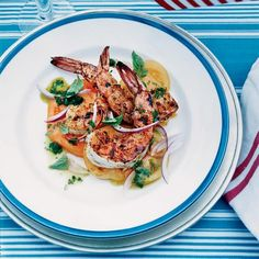 Barbecued Spiced Shrimp with Tomato Salad | The big, bold Southwestern flavors in this shrimp seasoning—which include pure ancho chile powder, smoked paprika, cumin and brown sugar—epitomize Bobby Flay's style. The seasoning mix would also be terrific on pork chops or beef tenderloin.