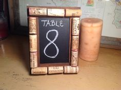rustic wedding table numbers made with wine corks on a chalkboard!