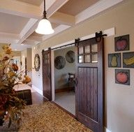 Would love these barn doors, seperating the kitchen from the dining room