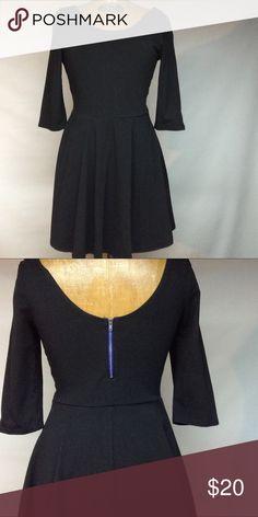 Black mini dress Black mini dress 3 / 4'sleeves - back zip not faded - excellent condition.  Armpit to armpit length 16' waist to bottom 17' Express Dresses Mini