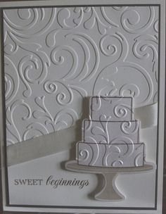 I love the illusion and depth on this handmade wedding card. The same Cuttlebug folder was used to emboss the background and the wedding cake. A satin ribbon and brown background as a liner really make this an elegant card.