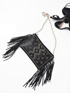 Embellished Fringe Clutch | American made leather clutch with statement fringe and mixed metal stud embellishment. Zip closure. Removable chain straps on; wear as a crossbody for versatile styling.