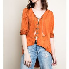 """""""Sea Fever"""" Faux Suede Lace Up Top Long sleeve faux suede lace up top. Feel like a boho rock star in this beautiful top! Available in camel and rust. This listing is for the RUST (first three photos). Brand new. 100% polyester. NO TRADES DON'T ASK. Bare Anthology Tops Blouses"""