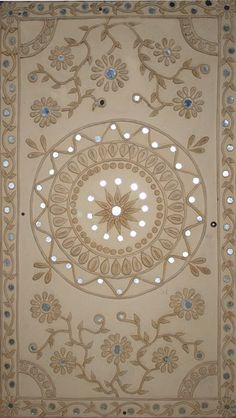 Traditional Indian Wall decoration - Lippan Art - Mud and mirror work also known as Lippan kaam is a traditional mural craft of Kutch,Gujrat. Lipan art dosen't have only decorative values but also helps in controlling the temperature within the huts as the clay is an insulation against heat and the mirror work-reflects light.