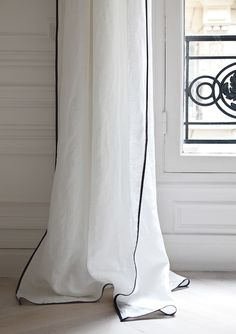 narrow black edges on white curtains