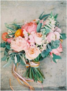 Peach, pink, orange, blue/grey foliage. Summer wedding Flowers at Barnsley House in the Cotswolds.