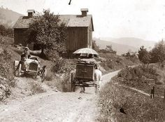 Buick roadster waits for horse drawn wagon to pass on narrow country road above Liberty, N.Y., 1912