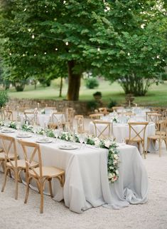 Wedding reception -- light gray cascading linen and natural wood crossback chairs