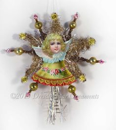 Dresden Star Ornaments - Victorian Angel on Bell with Tinsel Star Tree Topper and Glass Beads, $165.00 (http://www.victorianornaments.com/victorian-angel-on-bell-with-tinsel-star-tree-topper-and-glass-beads/)