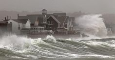 Waves crashed over homes on Turner Road in Scituate on Monday. Even though the landfall was in New Jersey, Massachusetts took a pounding from one of the biggest storms in history. (David L Ryan/Globe Staff)