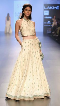 Keep it stylish !! Off white crop top with lehenga