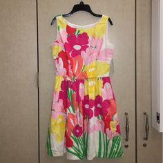 """Rare Lilly Pulitzer Aleesa Dress Selling this new Lilly dress with tags attached - size 4. So cute for a day at the races or at the country club! Print name: """"Resort White Lavish Lillys Placed"""" oh and did I mention POCKETS?? (Negotiable) Lilly Pulitzer Dresses Midi"""