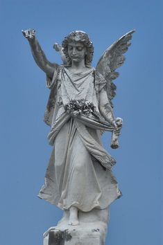 angel on a tomb  in Metairie Cemetery. New Orleans, Louisiana