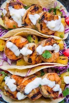 Shrimp Tacos with Pineapple Salsa, Slaw and Pina Colada Crema recipe