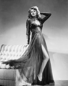 Rita Hayworth in negligee ~ 1940s ~ from  http://metroclassics.blogspot.com/2011_08_01_archive.html