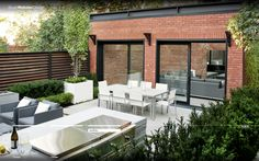 A bit too sleek for this house but like the clean black trim on brick and neatness overall - Stuart Webster Design